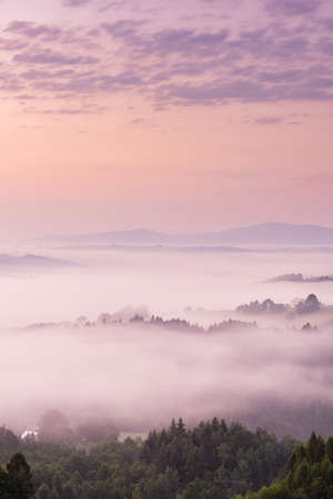Pink Sunrise with Clouds and Fog at Rolling Hills.