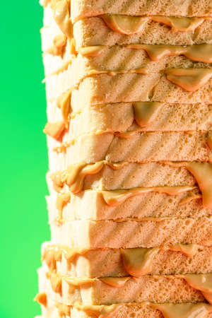 Bread with Peanut Butter  Sandwich Stack on Bright Background.