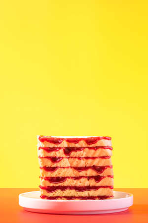 Bread Slices with Cherry Jam on Colorful Bright Background. 免版税图像