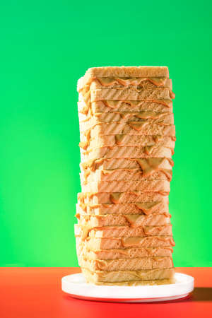 Peanut Butter Sandwich Tower. Bread Slices Stack on Colorful Background. 免版税图像