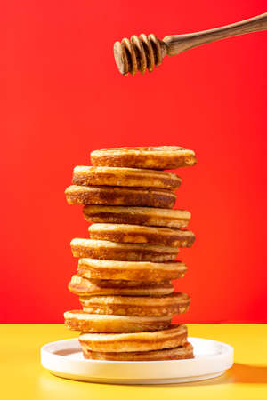 Pancakes Stack Tower and Honey Dipper. Breakfast Colorful Idea.