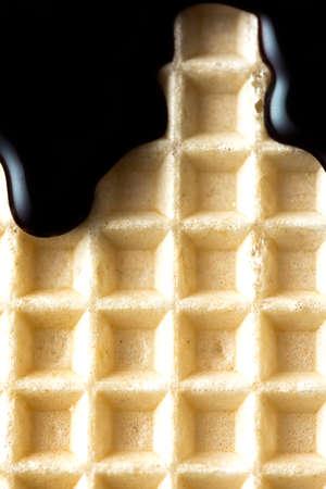 Dark Chocolate Glaze on Wafer. Sweet Food Texture Background. 免版税图像