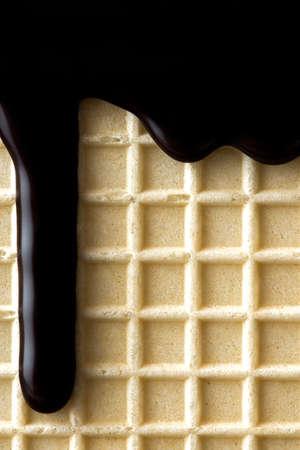 Chocolate Glaze on Waffel.  Sweet Food BAckground. 免版税图像