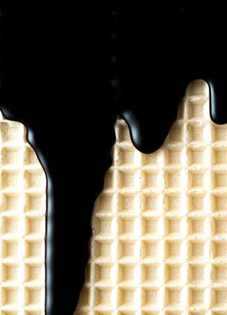 Chocolate Glaze on Waffel. Food Texture Background.