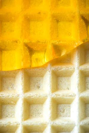 Honey Glaze on Waffel. Close Up View. Food Background. 免版税图像