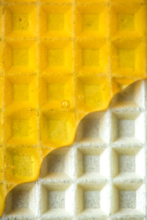 Sweet Honey Glaze on Waffel. Sweet Food Texture Background.