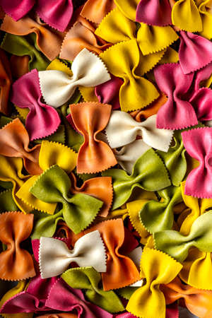 Ribbon Pasta Food Background. Colorful Raw Dry Pasta Texture .