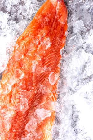 Fresh Raw Salmon Fish Piece on Ice.