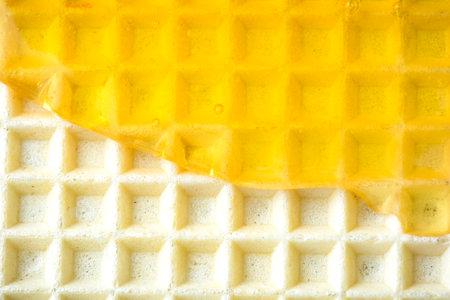 Honey Glaze on Wafer Closeup View. Sweet Food Background