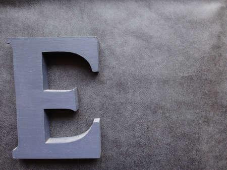 letter e on textured background