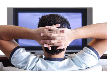 A young adult watching TV. photo