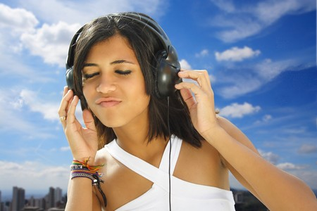 african student: Girl enjoying the sound.
