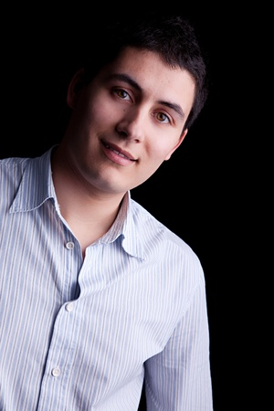 Handsome young man smiling. Isolated on black background. Stock Photo - 9568824