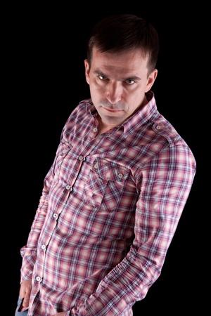 Portrait of seus man over dark background Stock Photo - 9651245