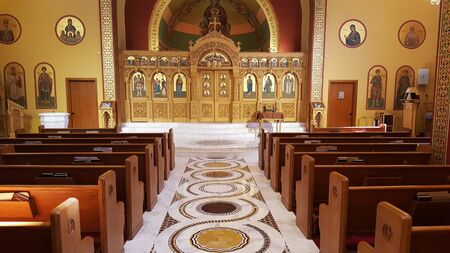 Looking down the aisle of a local Greek Orthodox church