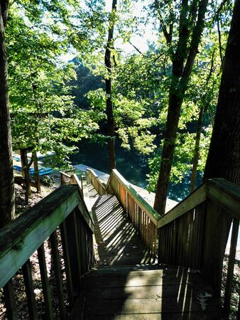 View looking down the stairs to the boat dock by the lake, at Blue Mountain Camp in Hamburg, Pennsylvania Imagens
