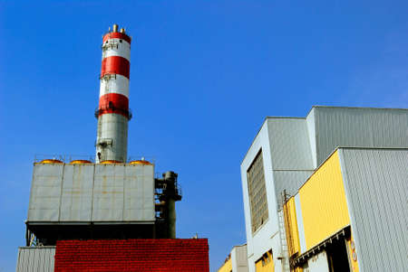 incinerator: Constructions of refuse incinerator power station over blue sky Stock Photo