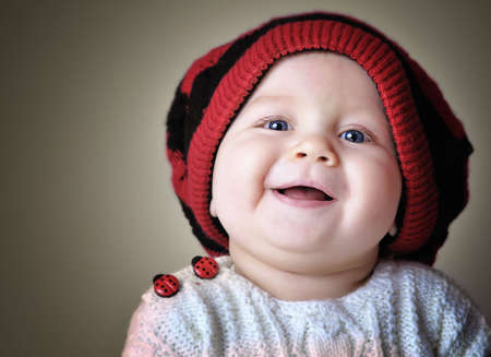 mischievous: Face portrait of smiling kid in red beret. Stock Photo