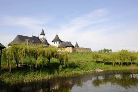 orthodox monastery on a river in spring day Stock Photo