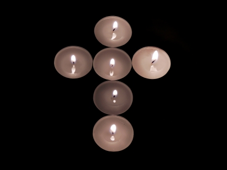 christmas prayer:           cross made with candles in the dark