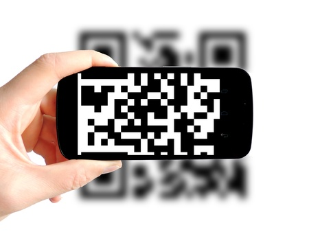 QR Code on smartphone isolated on white background