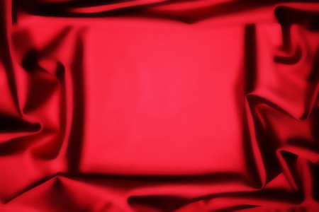 velvet background: soft red silk fabric frame in middle background
