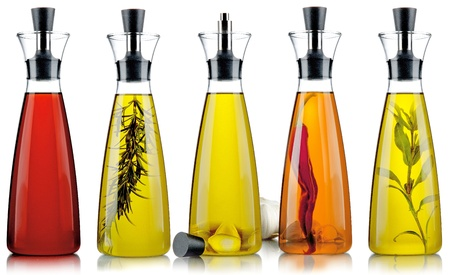 five types of bottles of oil and vinegar on white background