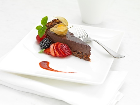 chocolate cake with strawberry and mint on a white plate Stock Photo