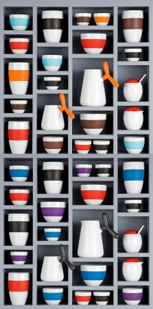 colorful ceramic cups on a shelf isolated on white background photo