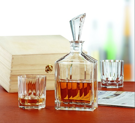 luxury crystal glass and bottle of whiskey on a wood table