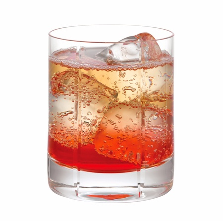 red cocktail drink with ice on a glass isolated on white background Stock Photo