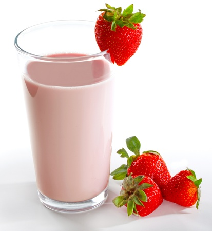 Strawberry milkshake on a tall glass on a white background