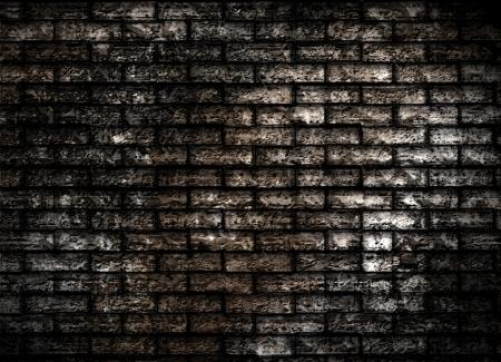 Dark old grunge brick wall texture wallpaper Stock Photo