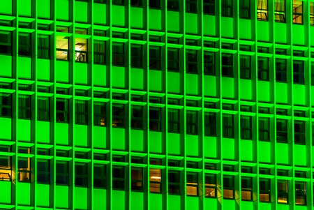horizontal image of a building with green lights Stock Photo