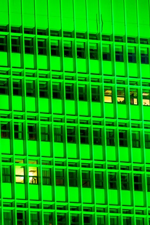 vertical Green of a tall building with windows at night