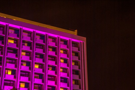 Pink building tall windows at night Stock Photo