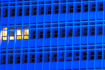 horizontal image of a Blue tall building with windows