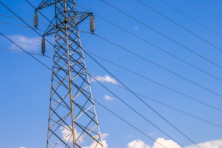 horizontal image of an electricity pylo in the blue sky
