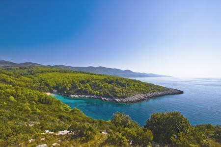 Sunny coast and beautiful bay on island Corcula in Croatia with perfect blue sky