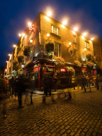 Dublin, Ireland, August 13, 2011: Temple Bar pub busy in the early evening