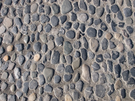 the cobblestones: Detail of the paved road structure