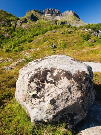 erratic: Rocky mountains of the Moskenesoy island, Lofoten, Norway Stock Photo