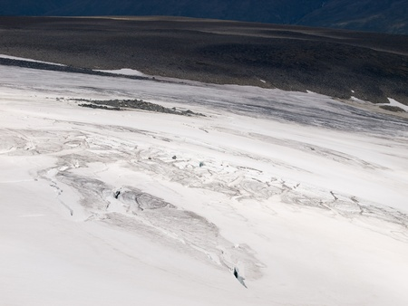 np: Glacier with crevasses under the Galdhoppigen Mt. in Jotunheimen NP Stock Photo
