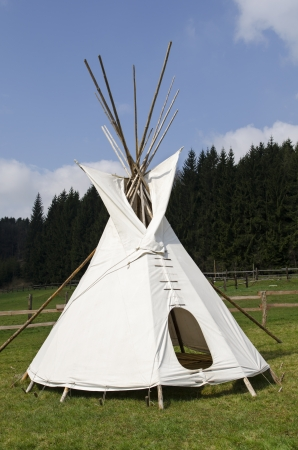 native indian: Native american wigwam on the meadow Stock Photo