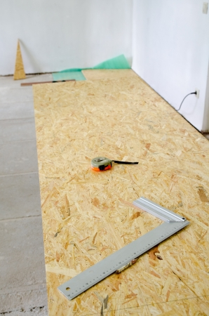 chipboard: Installation of insulation and chipboard floor Stock Photo