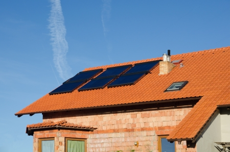 rooftiles: Solar collector on the roof of modern house