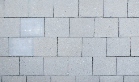 Detail of gray square tiles texture photo