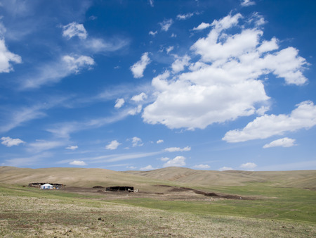ger: Mongolian steppe with typical ger and stables Stock Photo