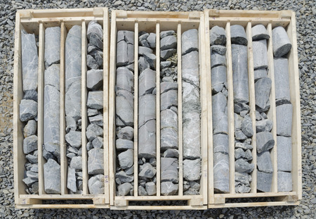 prospection: Diamond drilled rock cores of gold bearing ore ready for logging and sampling Stock Photo