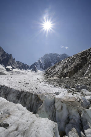 crevasse: Leschaux glacier with huge crevasse and mountain peaks in the French Alps Stock Photo